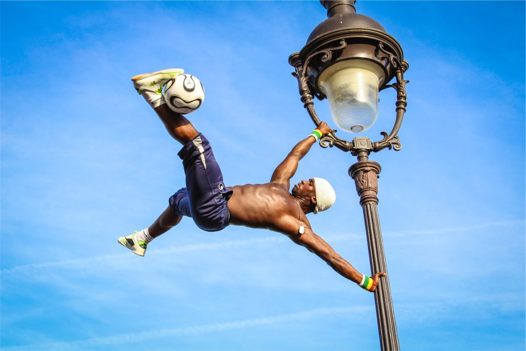 man performing flag pole hold