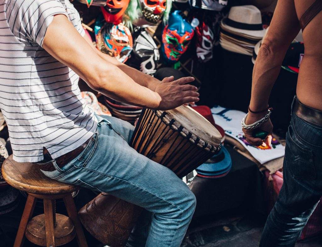 man playing the djembe