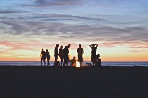 drum circle at the beach during sunset