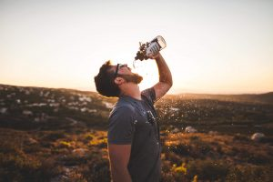 Man Drinking from Water Bottle