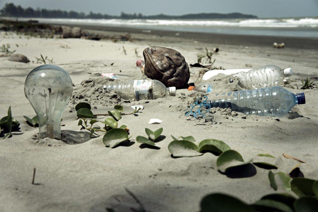 Pollution on a beach near the ocean.