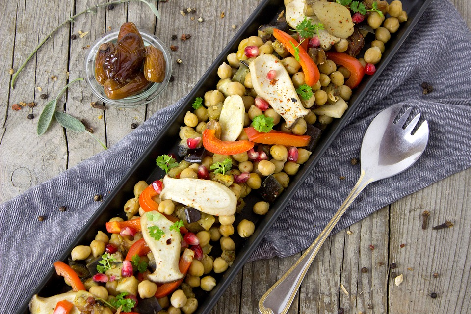 Vegetable spread with chickpeas, bell peppers, artichoke hearts, and parsley.